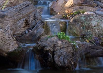 Residential Pondless Waterfall with Rock and Wood