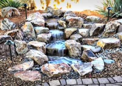 Pondless Waterfall with Different Size Rocks and Lighting