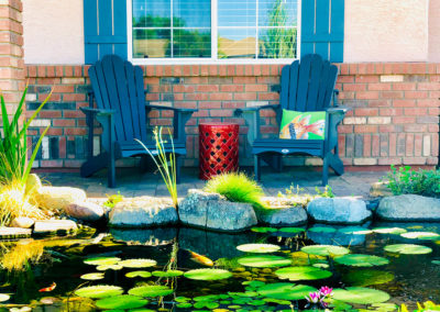 Koi pond with chairs and lily